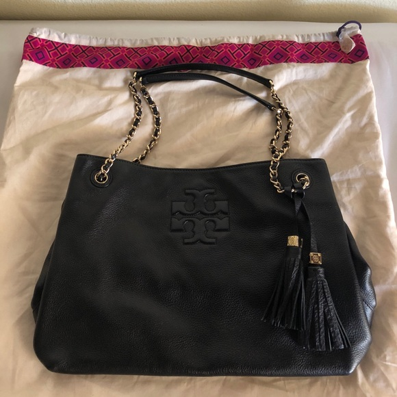 f77d9dc721c2 Tory Burch Thea Chain Shoulder Slouchy Tote. M 5adcde36caab4444b4d812e9